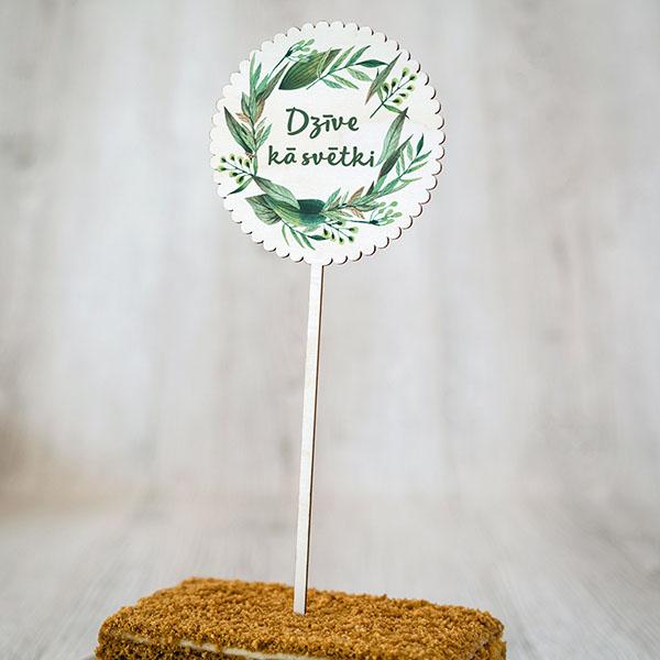 """Dekoratīvs kūku dekors ar krāsainu tekstu: """"Dzīve kā svētki"""""""