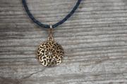 Baltu rotas, bronzas kulons ar Prūšu saules simbolu