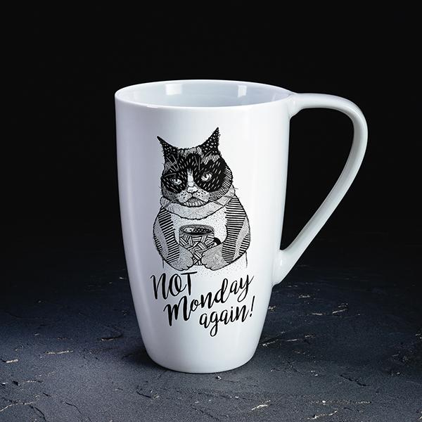 """Balta krūze ar melnu kaķa zīmējumu un tekstu angļu valodā: """"Not Monday again!"""""""