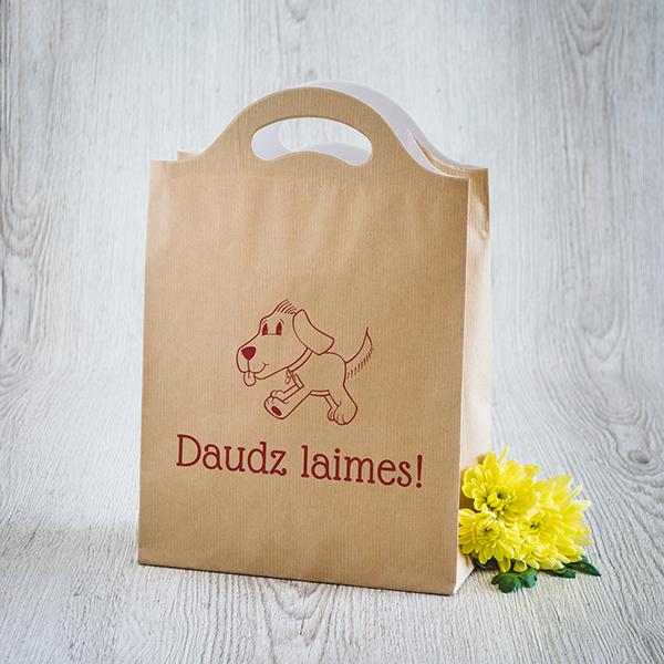Gaišs dāvanu maisiņš ar sarkanu apdruku ar suni ar tekstu Daudz laimes