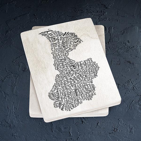 Balts magnēts ar melnu Latvijas kartes un pilsētu zīmējumu