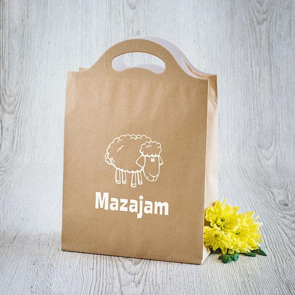 Gaišs dāvanu maisiņš ar baltu aitu un tekstu Mazajam