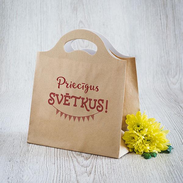 Gaišs dāvanu maisiņš ar sarkanu tekstu Priecīgus svētkus