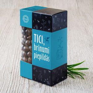 """Zemesrieksti šokolādē krāsainā kastītē ar tekstu: """"Tici, brīnumi piepildās!"""""""
