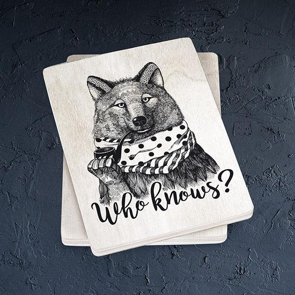 """Balts magnēts ar melnu vilka zīmējumu un tekstu: """"Who knows?"""""""