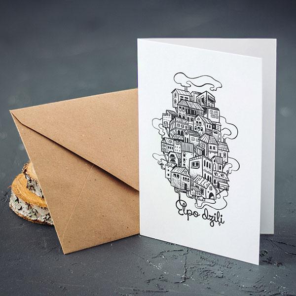 """Apsveikuma kartiņa ar pilsētas zīmējumu un tekstu: """"Elpo dziļi"""""""