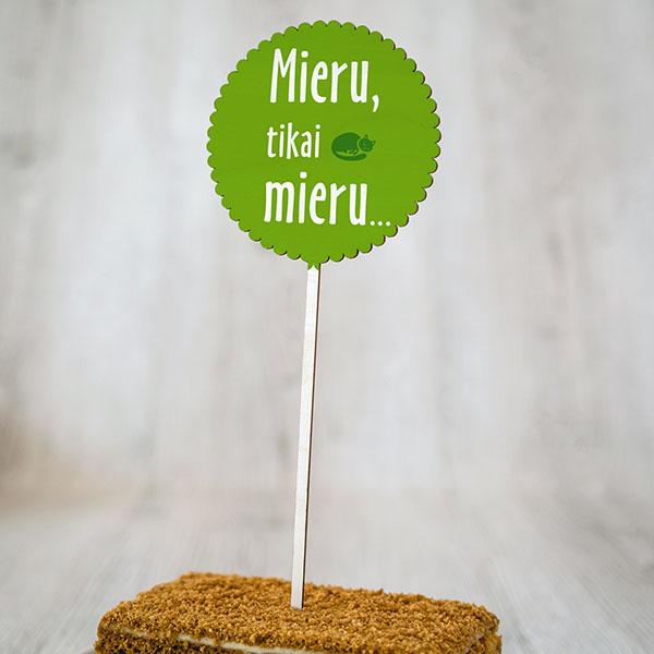 """Dekoratīvs kūku dekors ar krāsainu tekstu: """"Mieru, tikai mieru..."""""""