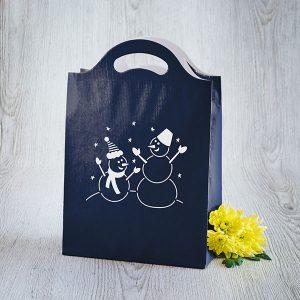 Dāvanu maisiņš ar sniegavīru zīmējumu