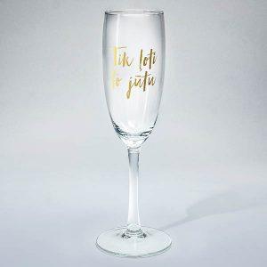 """Šampanieša glāze ar zelta tekstu: """"Tik ļoti to jūtu"""""""