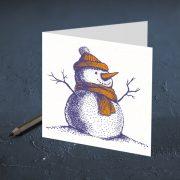 apsveikuma kartīte ar attēlotu sniegavīru